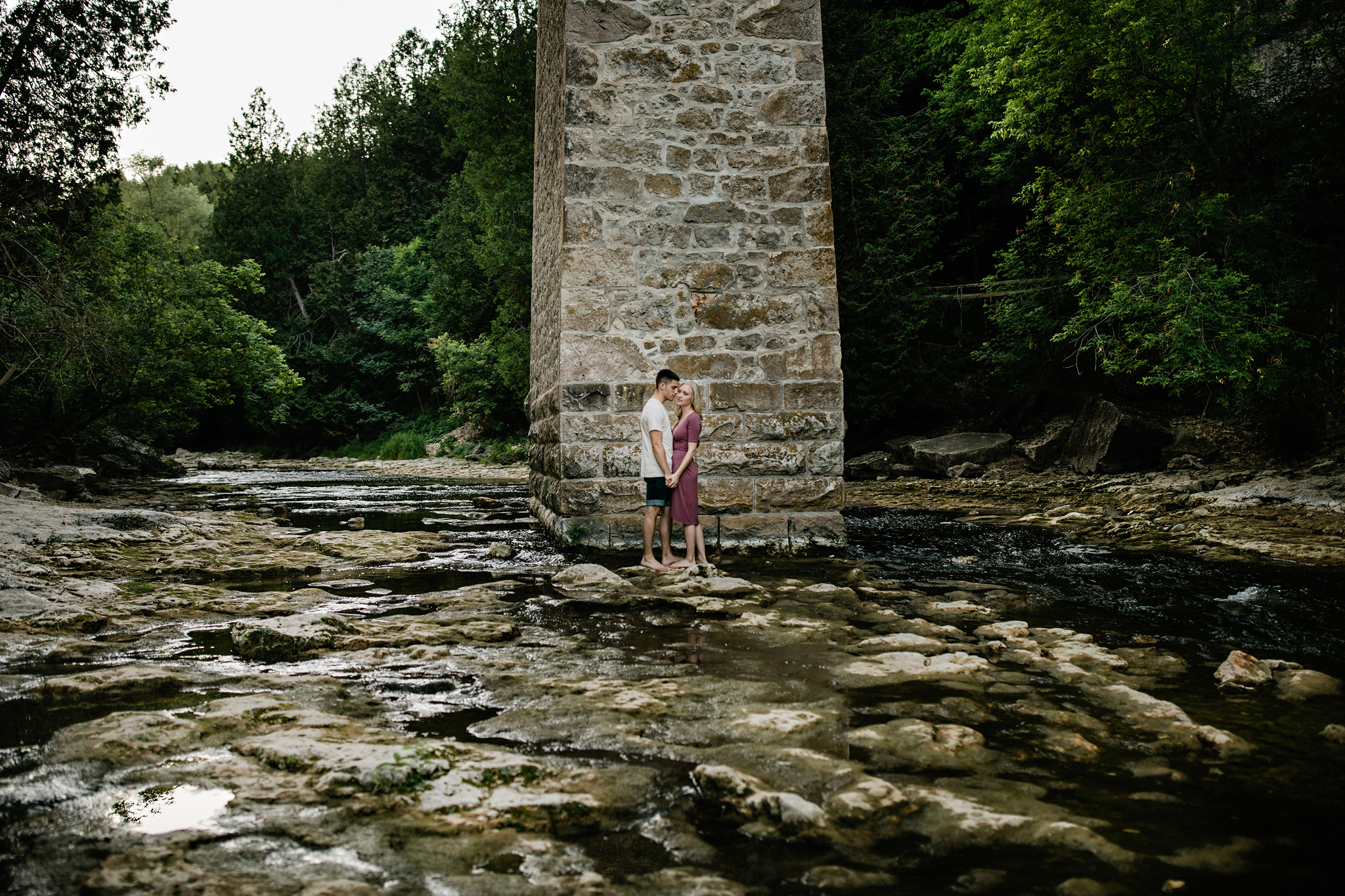 251-romantic-summer-elora-gorge-sunset-engagement-session.jpg