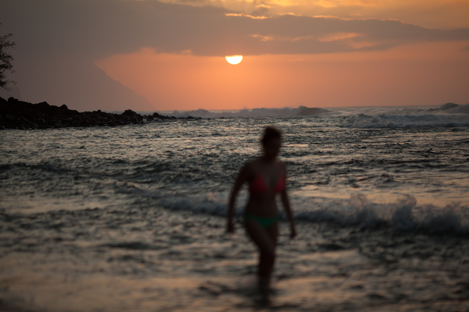 Katy in the sunset surf, Hawai.