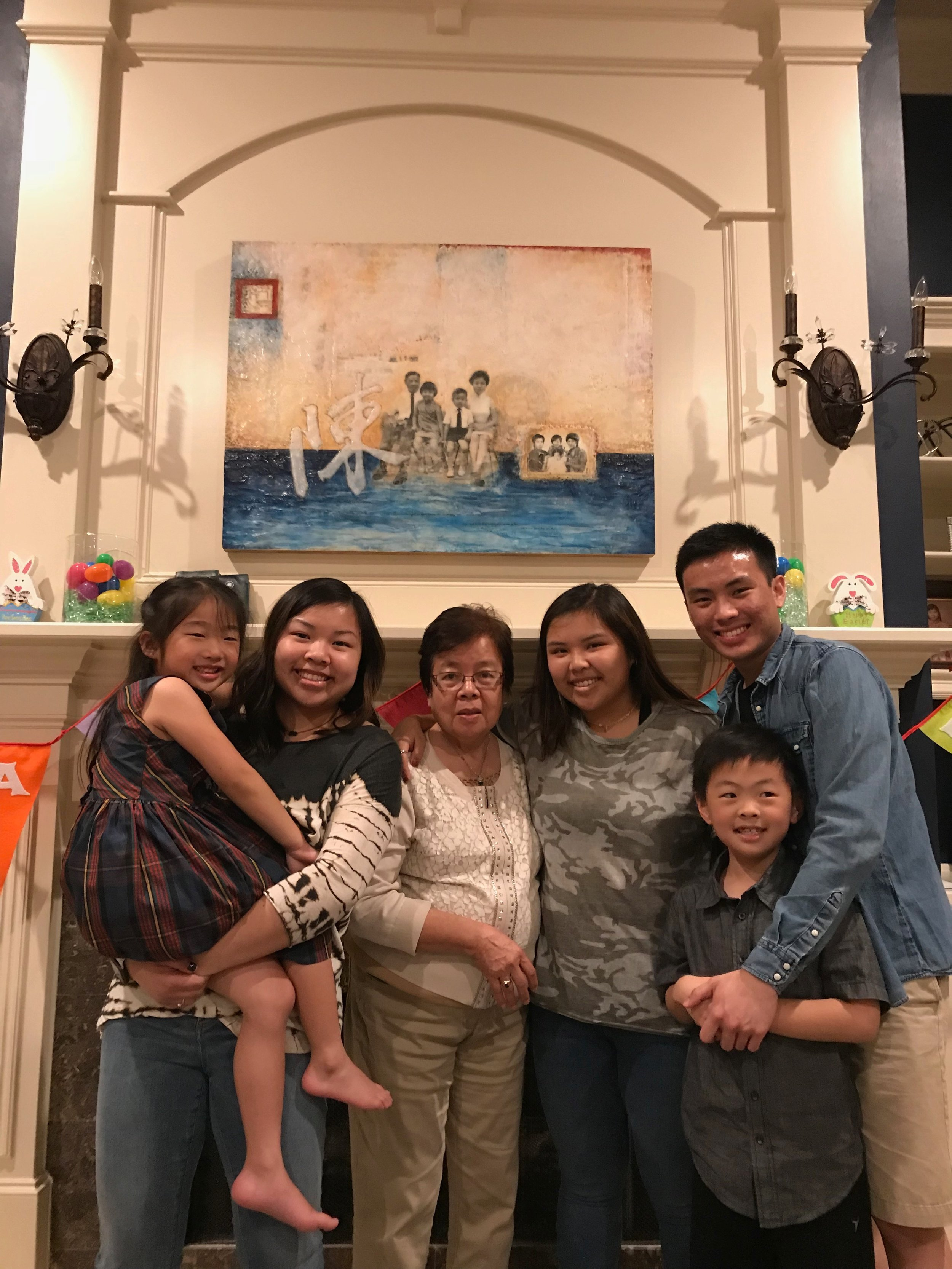 All of the Chen grandkids with Grandma Chen in front of the finished piece!