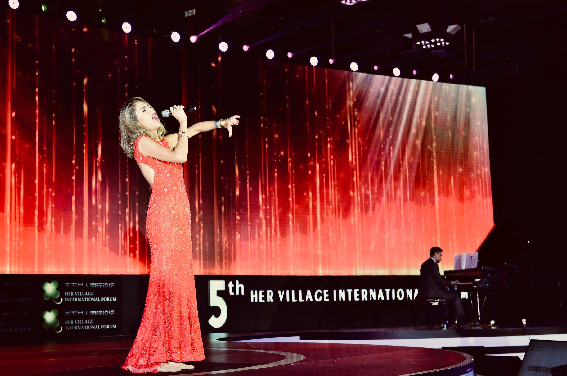 performing at Her Village International Forum in Beijing, China