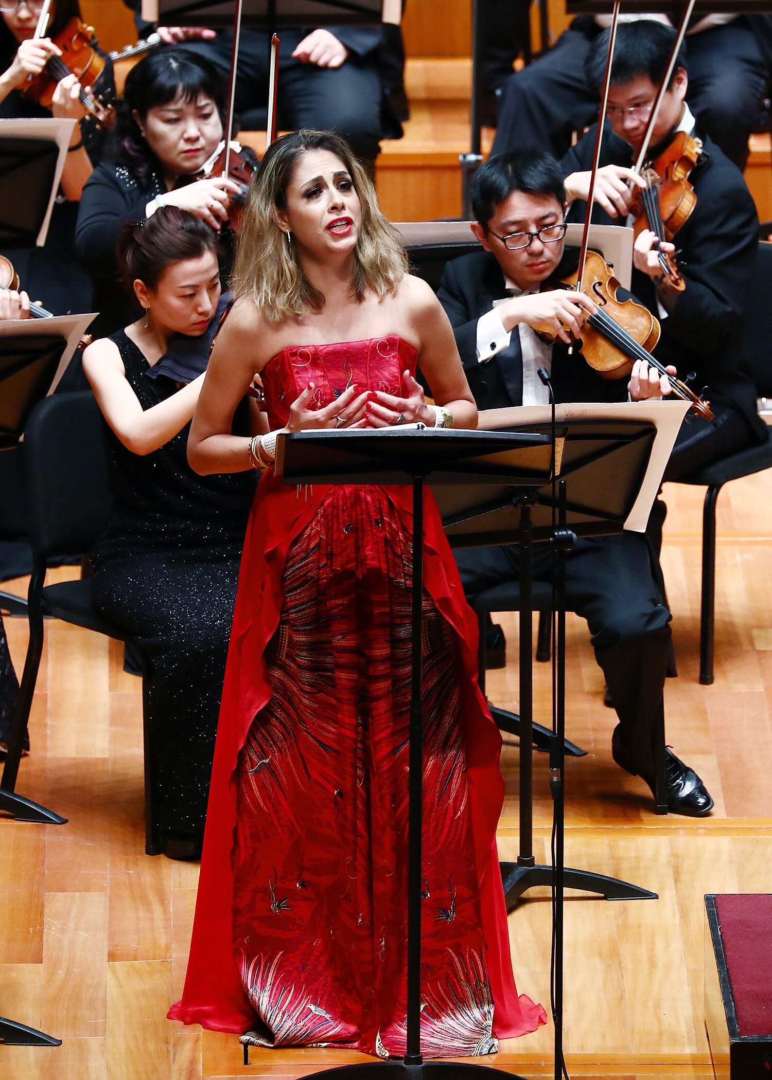 performing with the China National Symphony Orchestra in Beijing, China