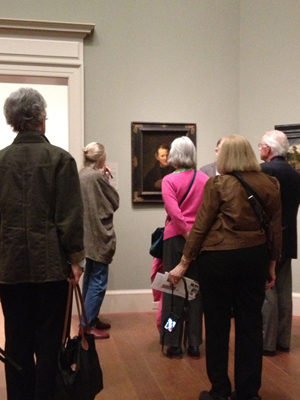 Seminarians contemplating Rembrandt's 'St. Bartholomew' -- a piece that was once stolen from WAM