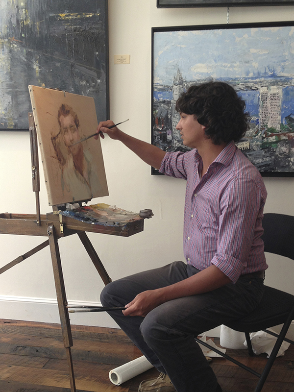 Leo painting during a portrait demonstration in March 2013.