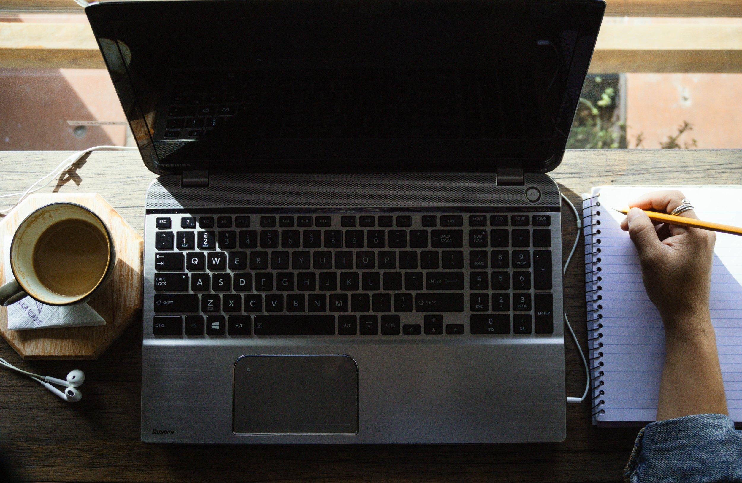 computer journal coffee kat-stokes-1157386-unsplash.jpg