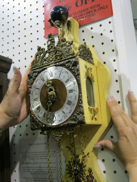 Step 2 Make sure your clock is straight. If the clock is pitched too far forward or backward, the pendulum might hit the inside casing and will not run properly.