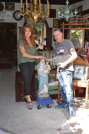 Laura Curtis, owner of Europa Imports Inc in Helotes, Texas, hits the European antique picking trail with our picker Marcellino Van Hoof.