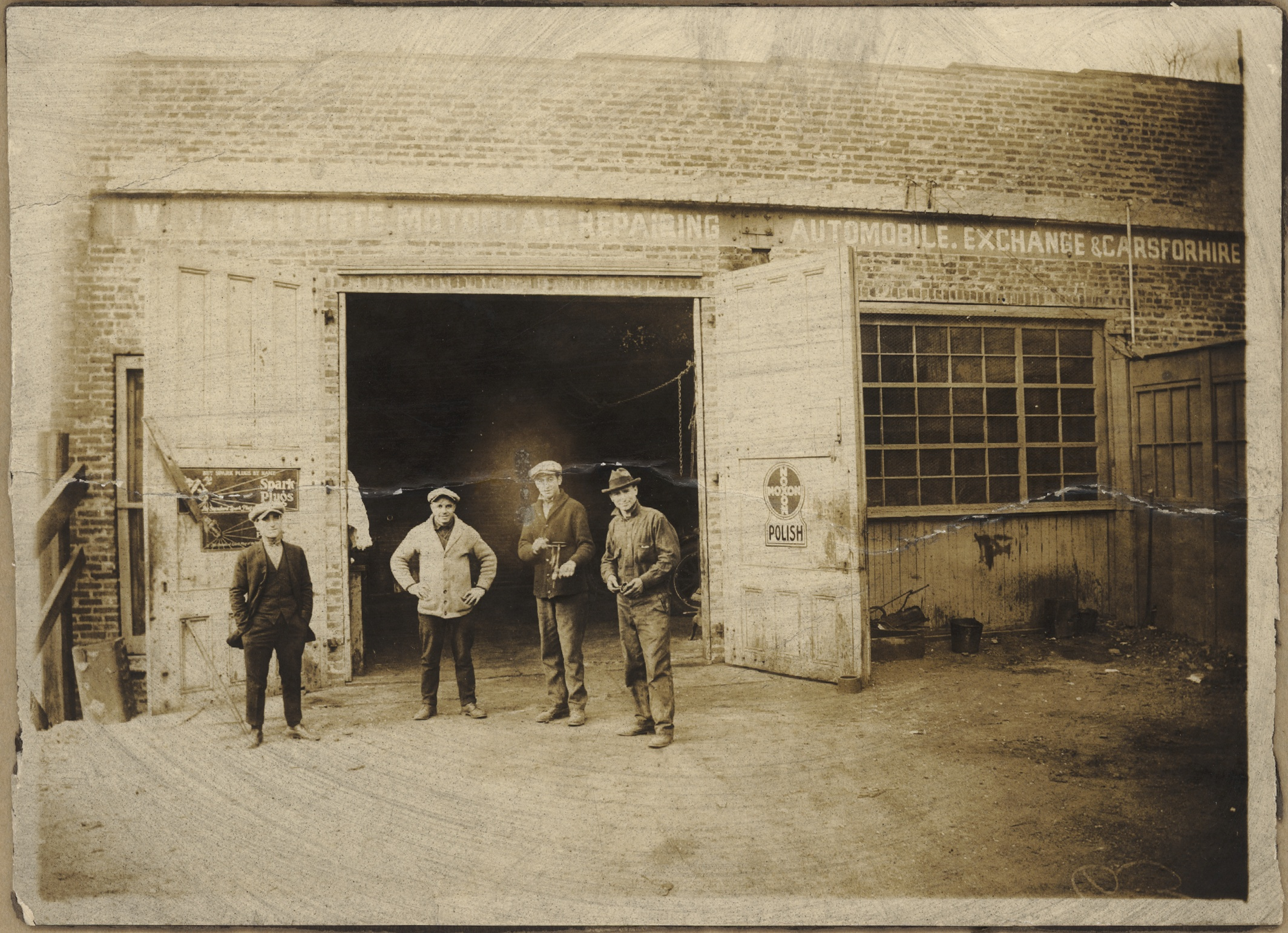 1920s Bayonne, NJ  First garage with indoor car lift, owner William 'Willy' Acquiste [far right]. Joseph changed to William to be more American.
