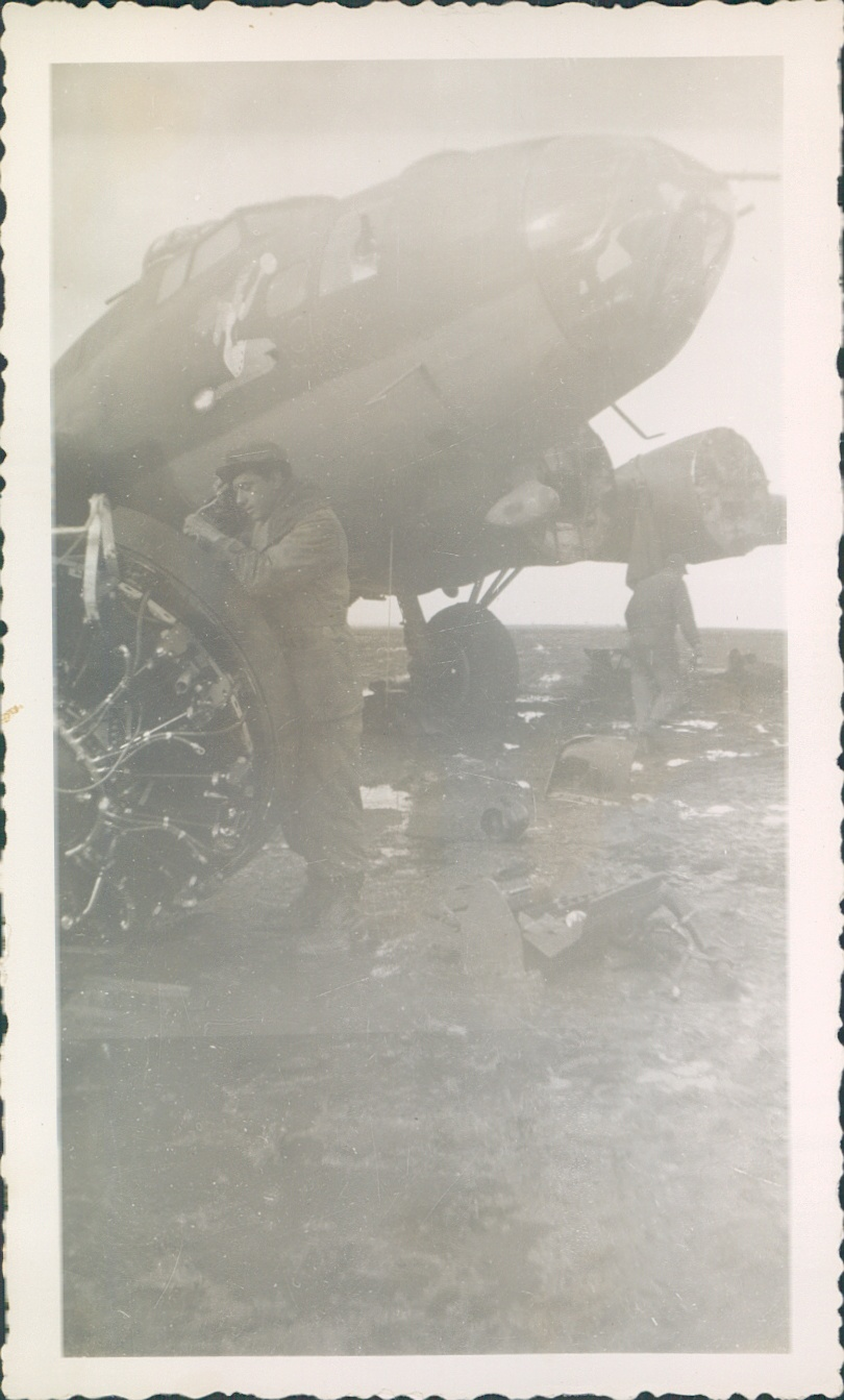 Carbone [foreground] working on B17 bomber.