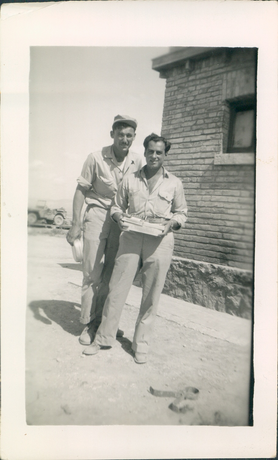 """September 1944 Italy  Ration Day - cigarettes, candy, soap, etc, and tickets for 5 bottles of beer, and two cokes all for $1.60. The Guy behind me is the tallest in the sqdn. about 6'5"""". - E. Carbone"""