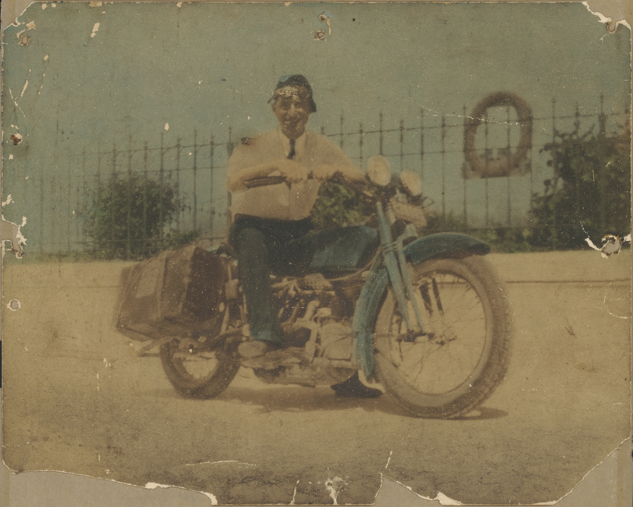Date unknown.  Joseph Acquiste, on motorcycle he built and toured Italy on.