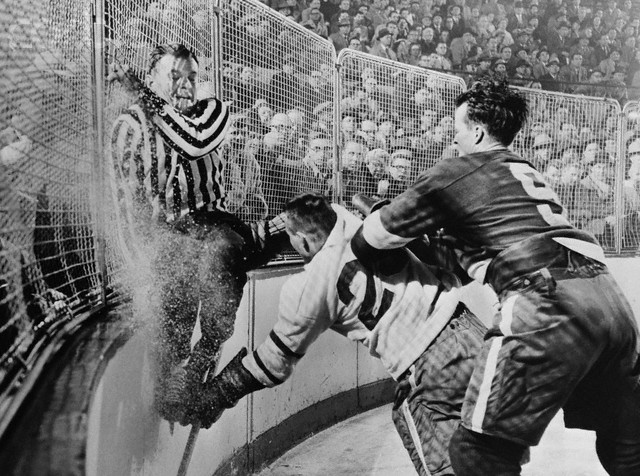 Gordie Howe finishes a check. March 20th, 1956.