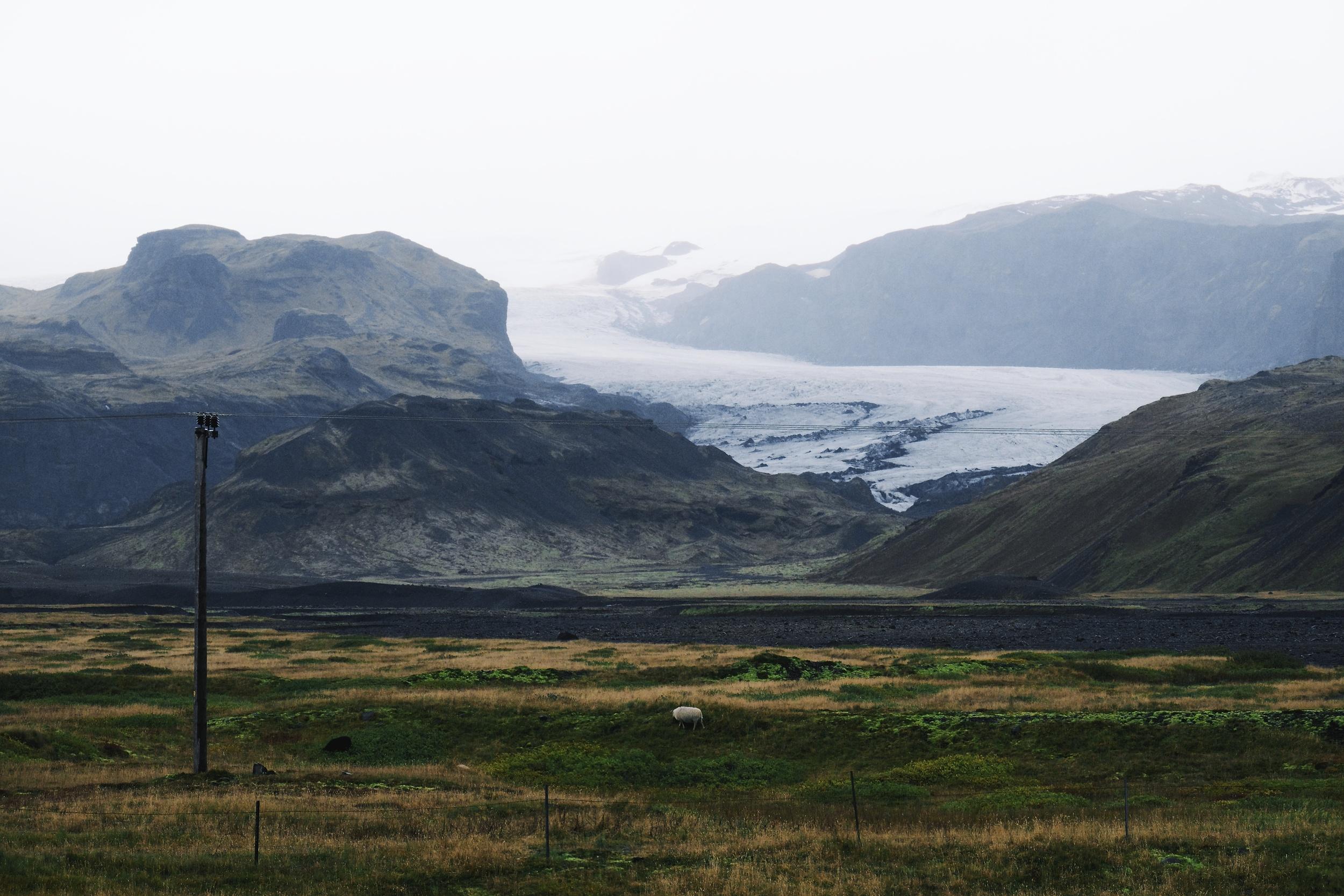 Ring Road towards Vik. First look at a glacier tongue.  Fuji: f8 @ 95mm, 1/640, ISO1600