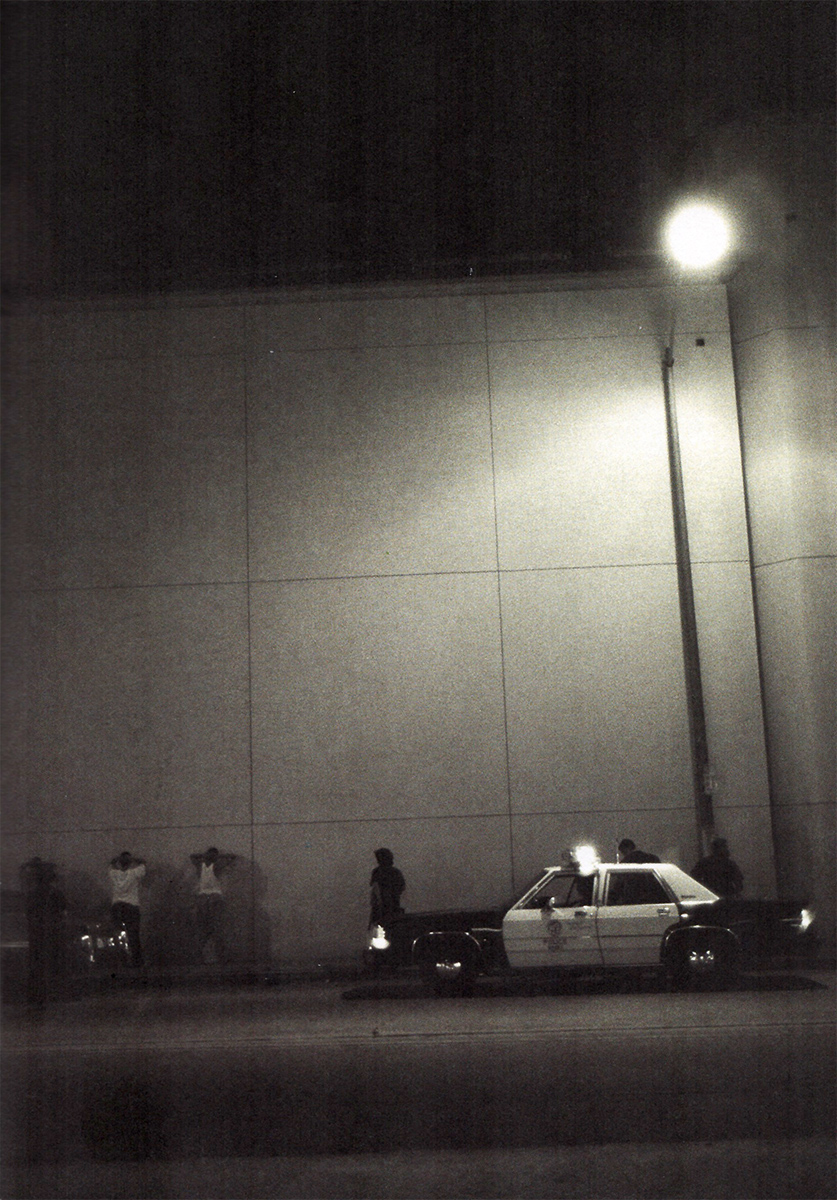 Los Angeles Police Department (LAPD) officers arresting suspects, Los Angeles, 1990s