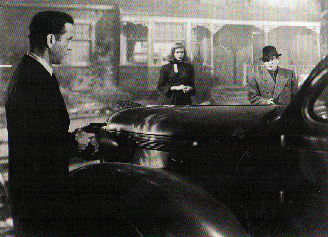 Humphrey Bogart as Philip Marlowe with Lauren Bacall as Vivian Rutledge in  The Big Sleep .
