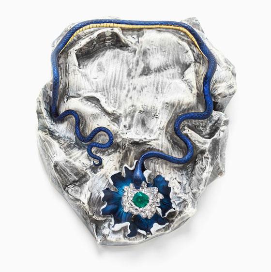 Lunae Lumen Satine Mummy Blue, 2013, Y  ellow and white gold, platinum, emerald, diamonds, colored lacquer, 2  3/4 x 6 5/16 x 8 11/16″