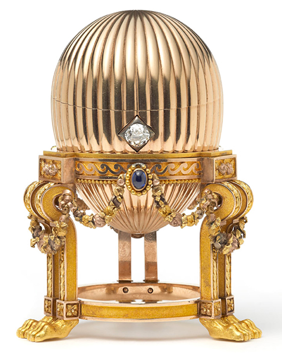 The 3.2-inch Faberge egg  has three sapphires suspend golden garlands around it, and a diamond that acts as an opening mechanism.