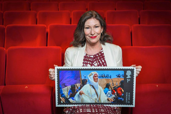 Actress Kate O'Toole in a familiar setting, with the newly-minted stamp honoring her father Peter O'Toole with a shot of him as Lawrence, his greatest role.
