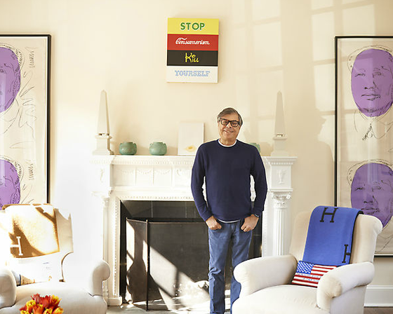 Bob Colacello at home, flanked by Warhol's Maos with a Josh Bricker above the mantel