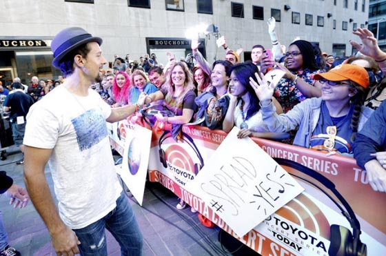 With fans in Rockefeller Center