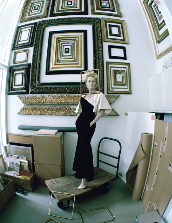 In the framing department of the Menil Collection, Swinton wears Calvin Klein Collection