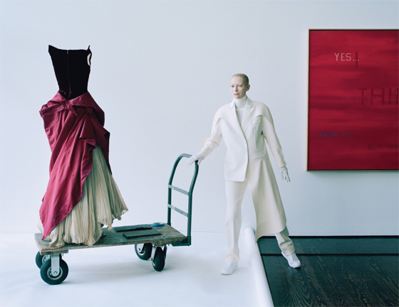 In the entrance of the Menil Collection, Swinton wears Balenciaga, flanked by Charles James's March of Dimes dress, 1949, and Edward Ruscha's Indecision, 1982.