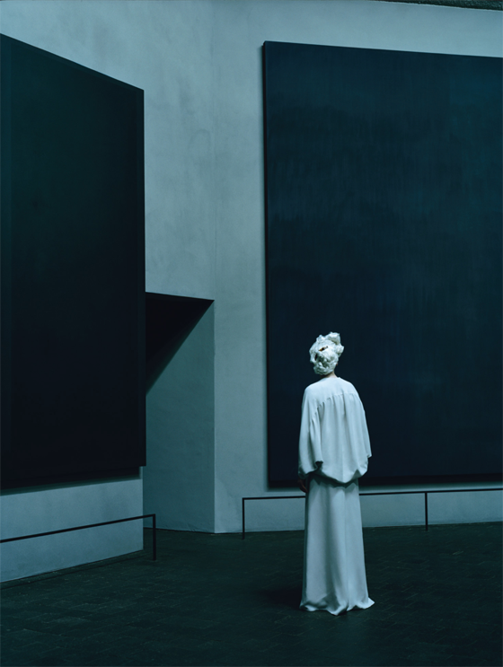 In the Rothko Chapel, Swinton stands before a canvas by Mark Rothko in Valentino