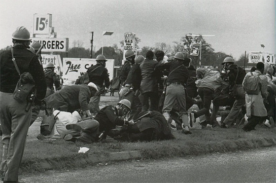 """Charles Moore – Almost Immediately After Telling Marchers They Had """"Two Minutes To Disperse"""" The State Troopers Charge With Their Billy Clubs, Selma, Alabama, 1965"""
