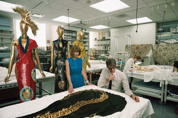 Wintour and Andrew Bolton in a conservation room at the Met's Costume Center. Photographed by Annie Leibovitz
