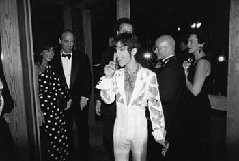 Kevin Sessums is to the right of Prince, critic Gene Siskel on the left…