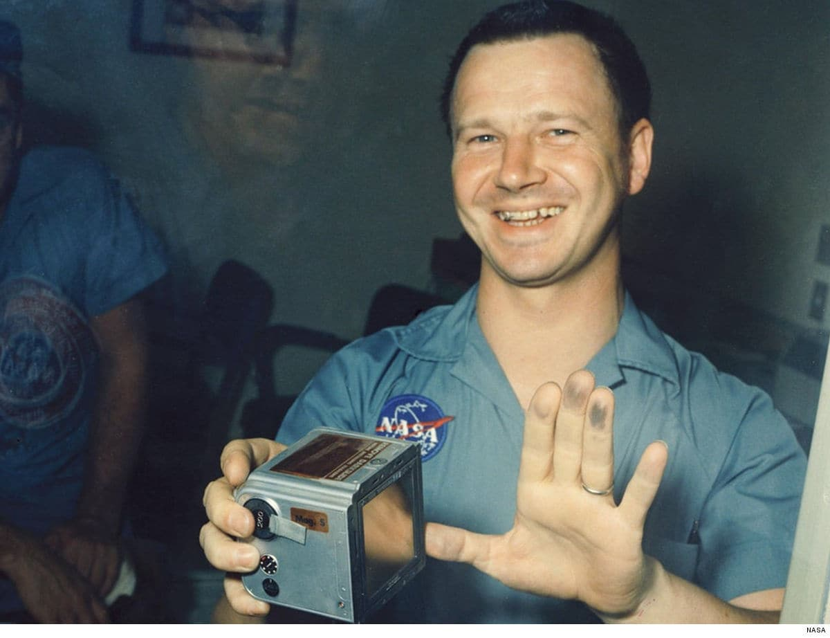 Terry Slezak with moon dust on his hands from one of Apollo 11's film canisters.