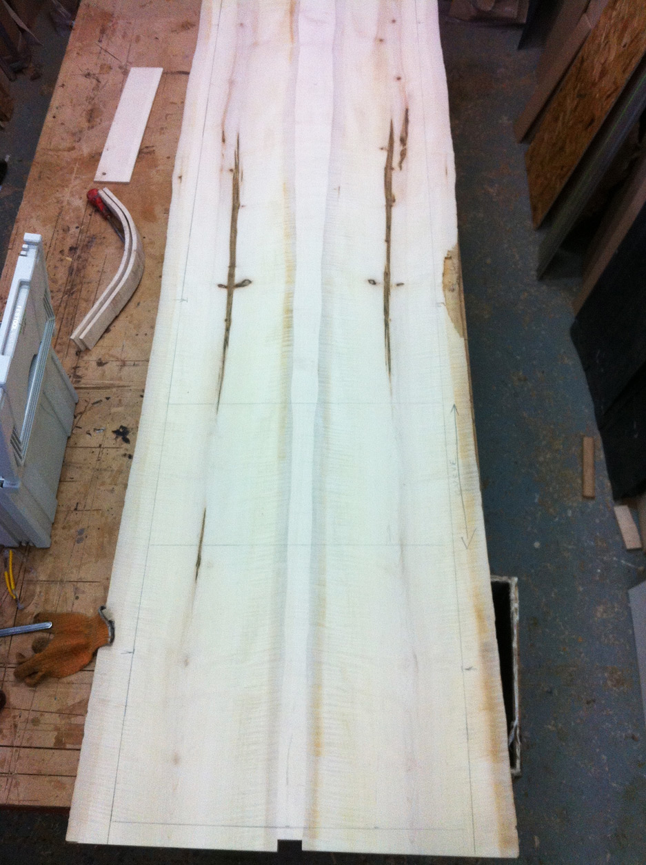 The picture shows two pieces of solid ripple sycamore over three metres long and 60cm width, are joined along the waney edge with a narrow infill.