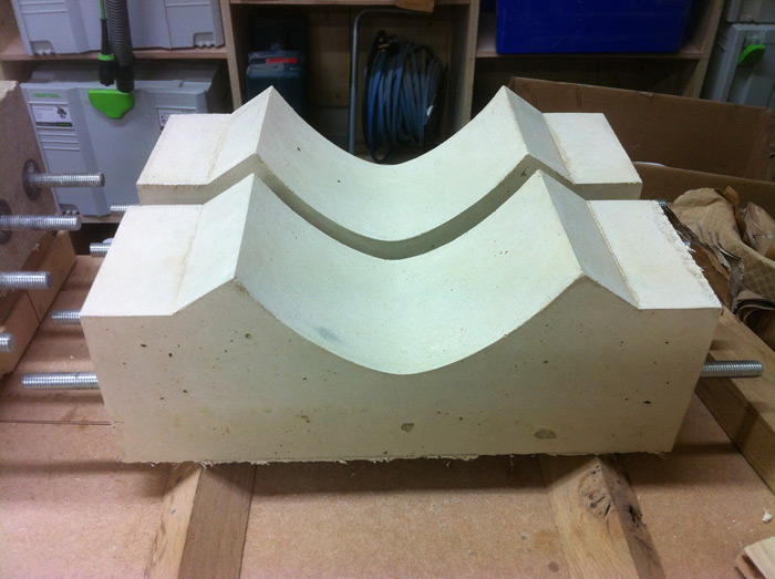 The concrete is taken out of the mould and left to dry further. The steel bolts running through are for strength but also to attach the curved oak leg uprights.