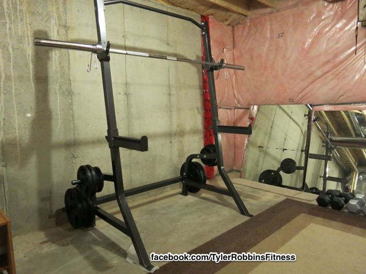 A picture I snapped early 2013 after I purchased an assembled my squat rack. This gives you a basic idea of my basement.