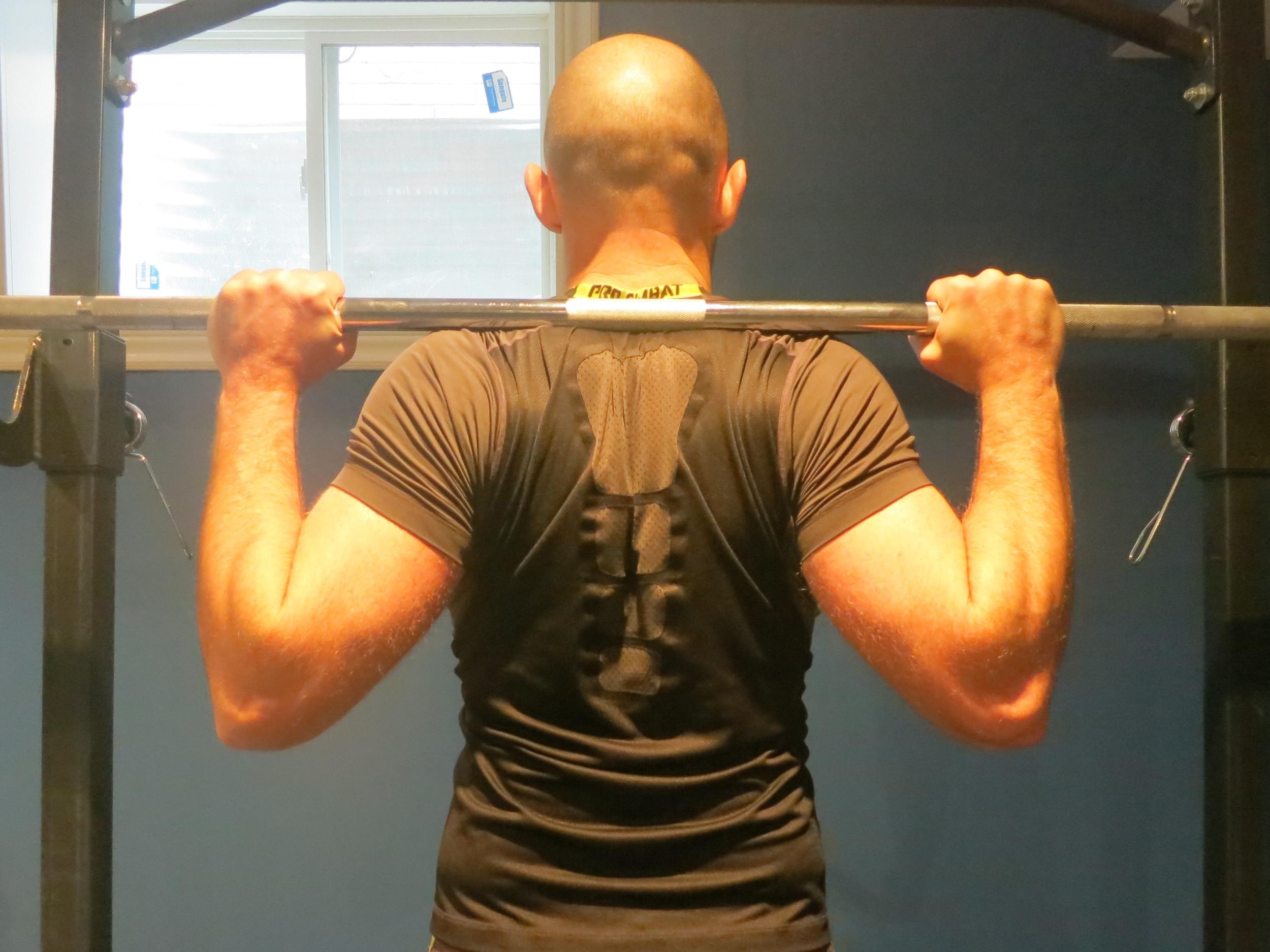 High-bar back squat racking position