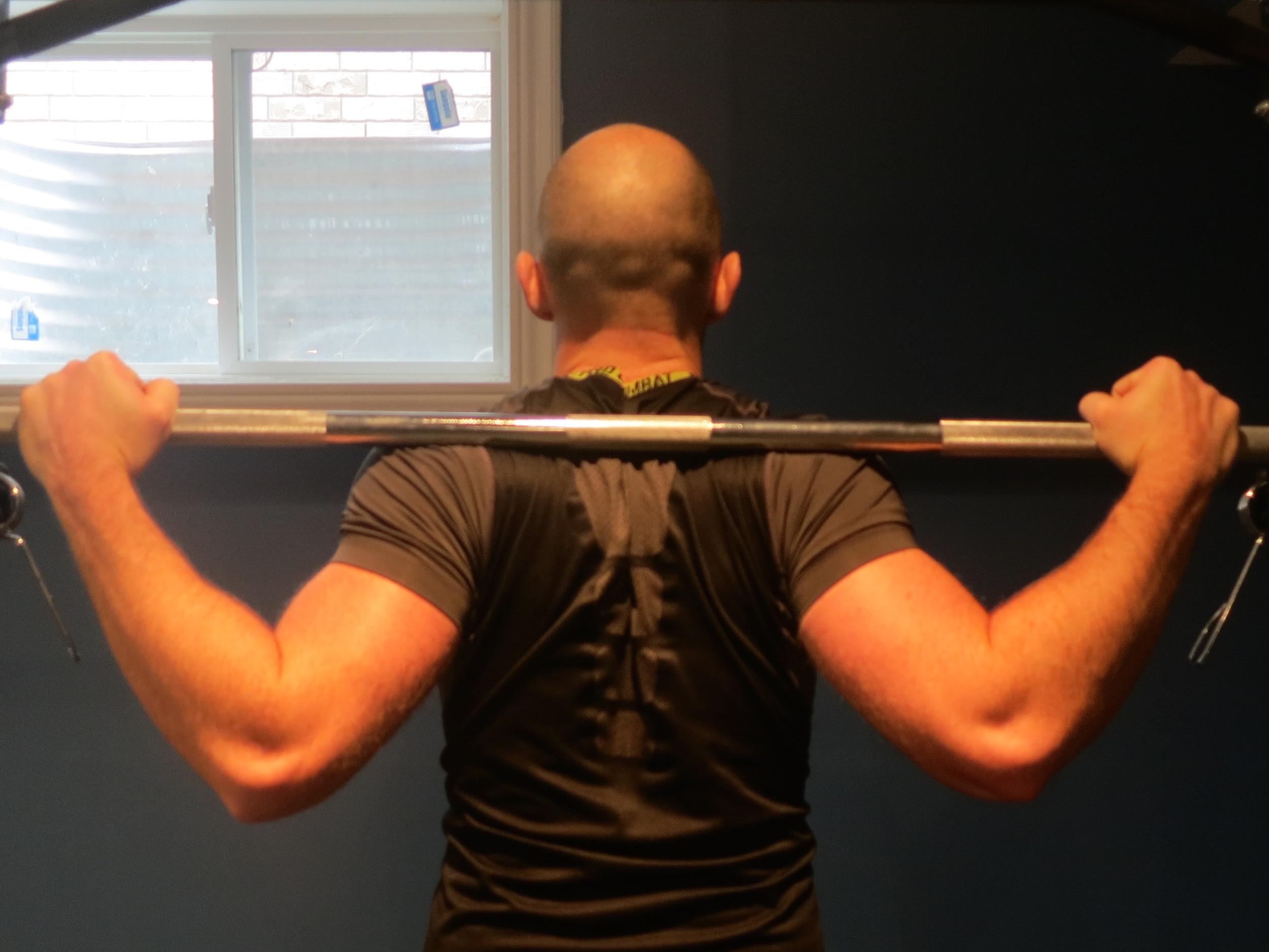 Low-bar back squat racking position