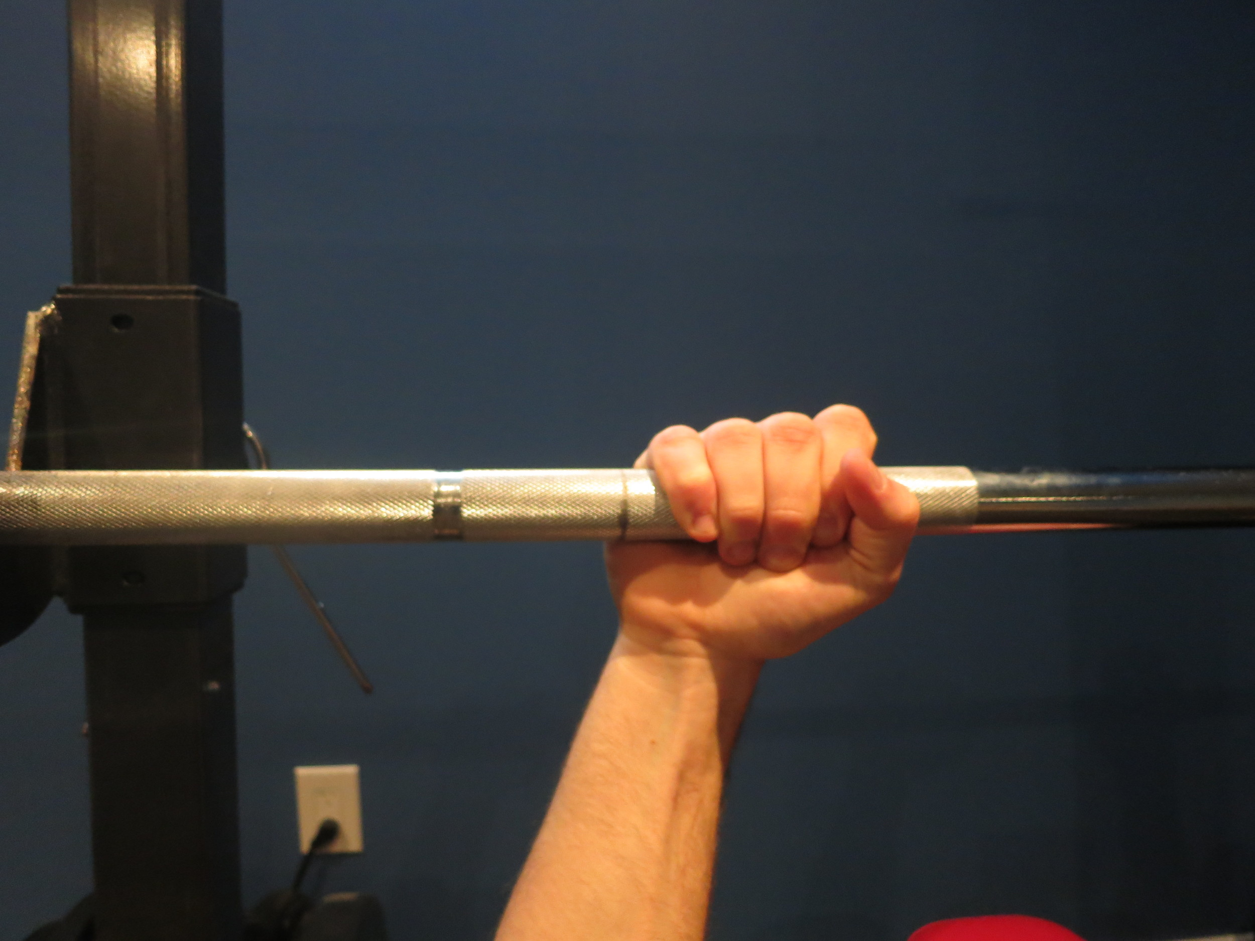 Instead, let the bar sit more in your palm, closer to your thumb.