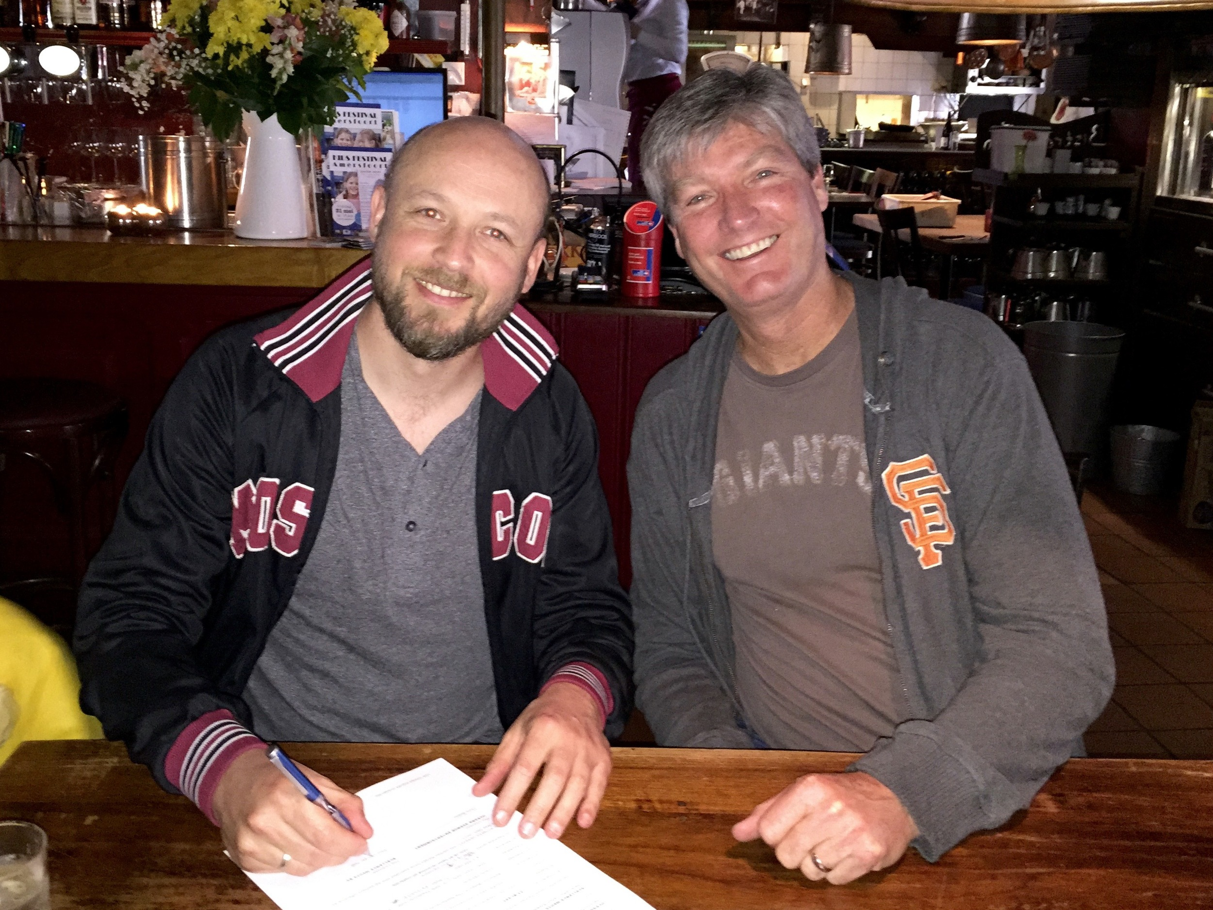Paul van der Niet and Chris Bueno signing the agreement in Amersfoort, Holland to distribute 23 BLAST in the Netherland.
