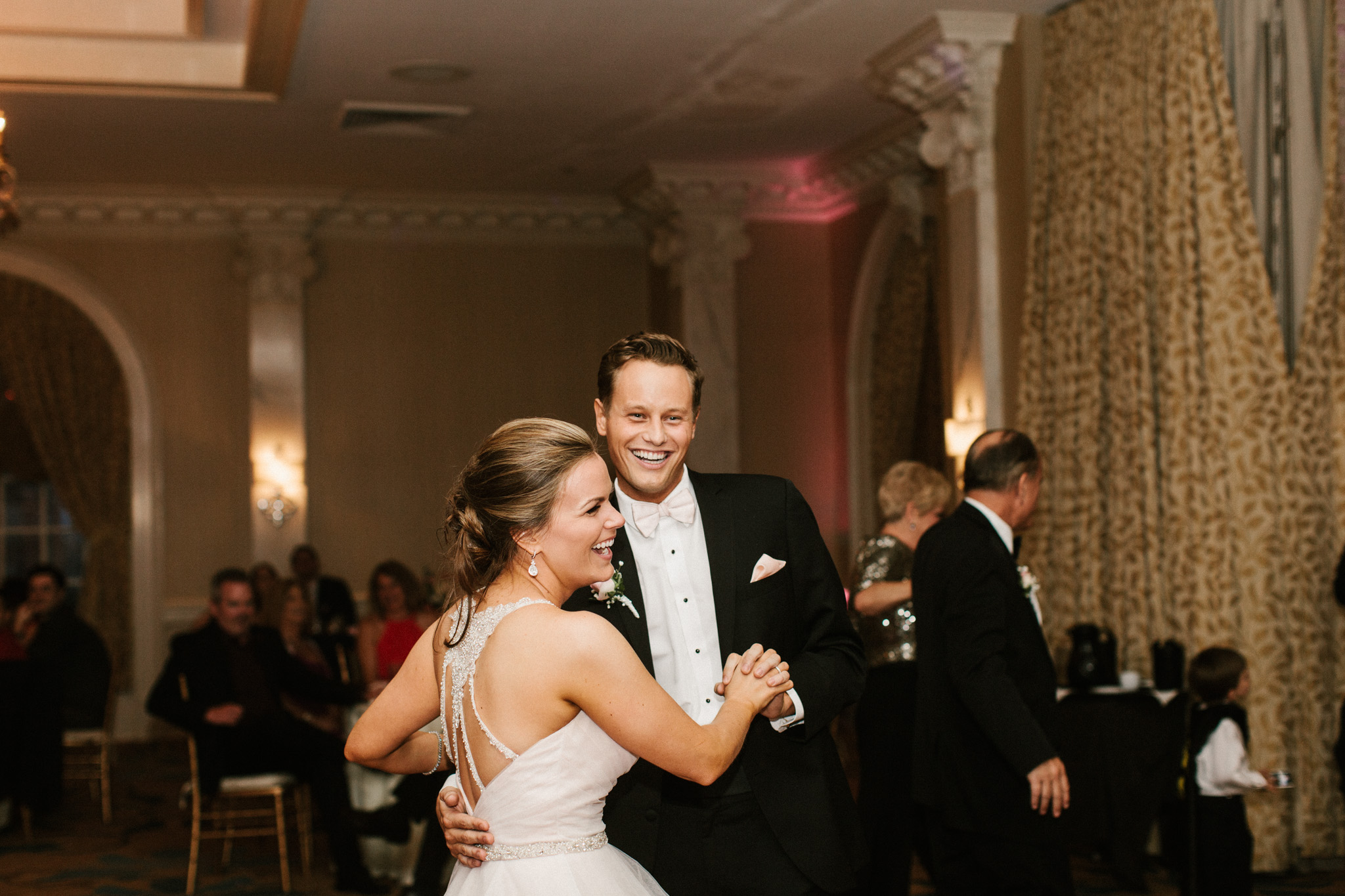 bride and groom dancing reception