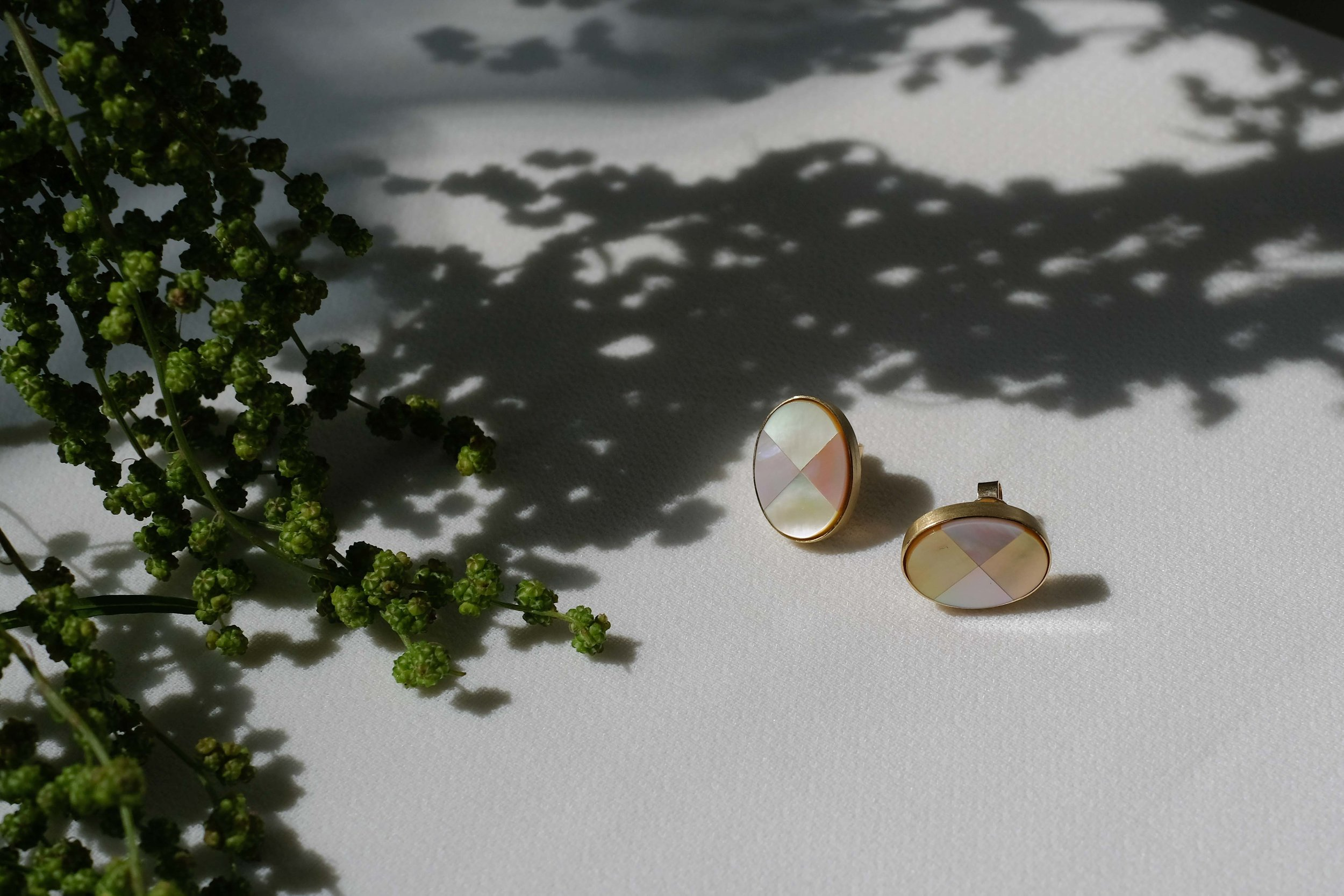 Dolce Earrings   Divided in quarters of pink and amber, this sweet looking wonder is a sight that melts the heart.