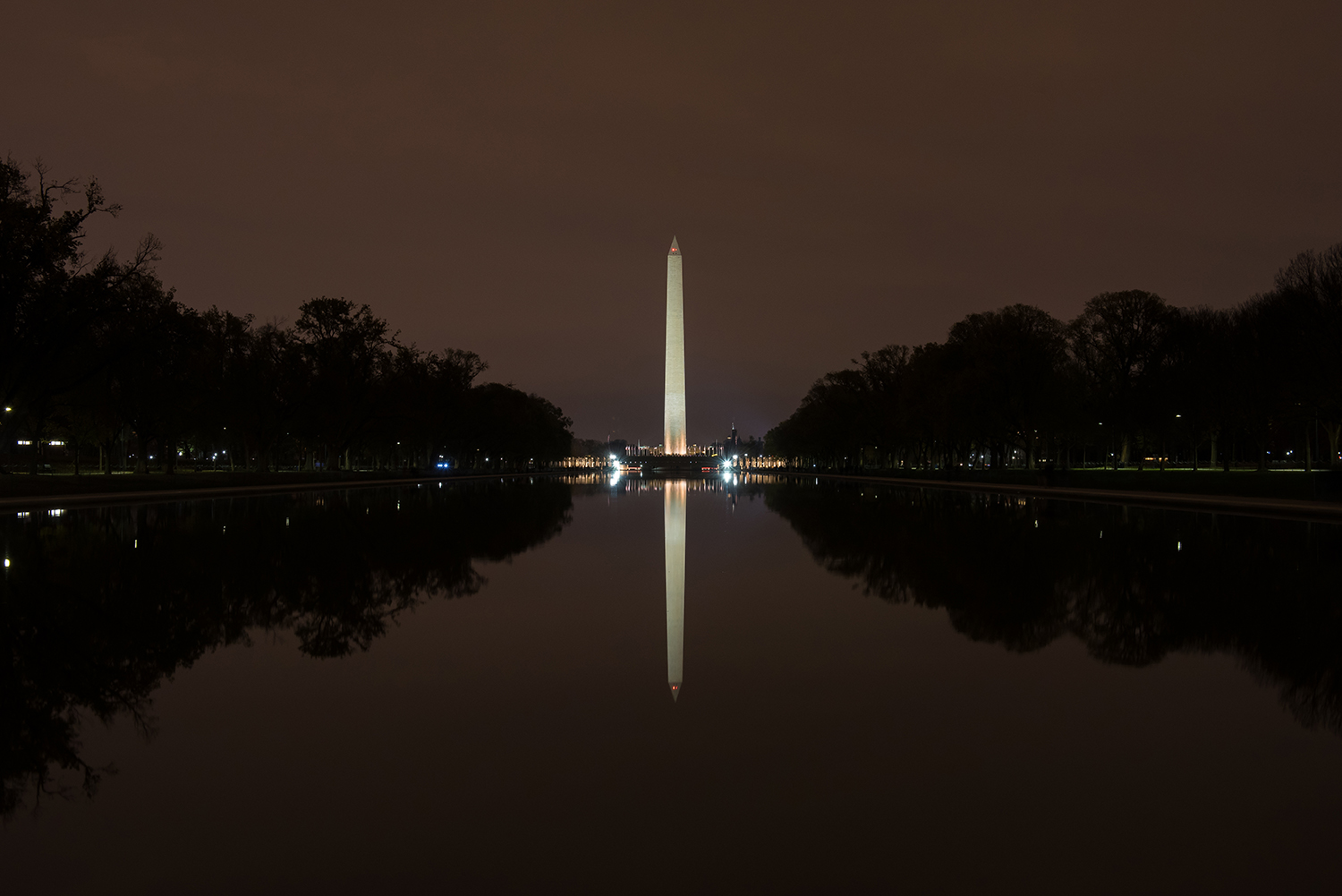 The Washington Monument as seen from the Lincoln Memorial on a perfectly still night.