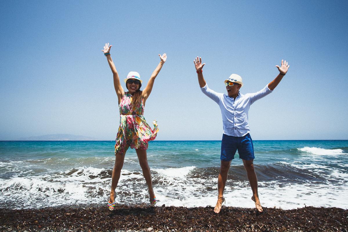 fun honeymoon photoshoot, Greece, destination photographer, couples beach photos