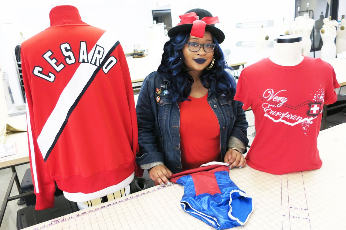 "Moore alumna Yolanda Jernigan '03 is making fashion that's ""Ready to rumble"" in the pro wrestling ring. Click link  here  for full interview."