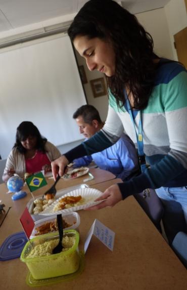 Nirit, tasting her own family recipe.  (Photo: Monica Ma/ UCLA)