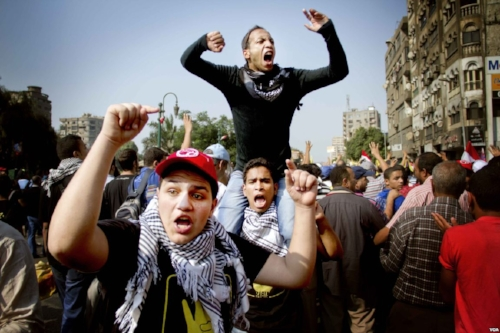 Protesters on the streets of Cairo, October 2013. (PHOTO: Voice of America Via  Wikimedia Commons )