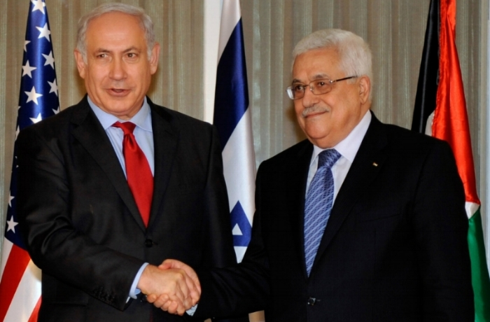 Israeli Prime Minister Benjamin Netanyahu and Palestinian president mahmoud abbas shake hands in Jerusalem, september 2010 [photo:  us dept of state  via flickr. image cropped]
