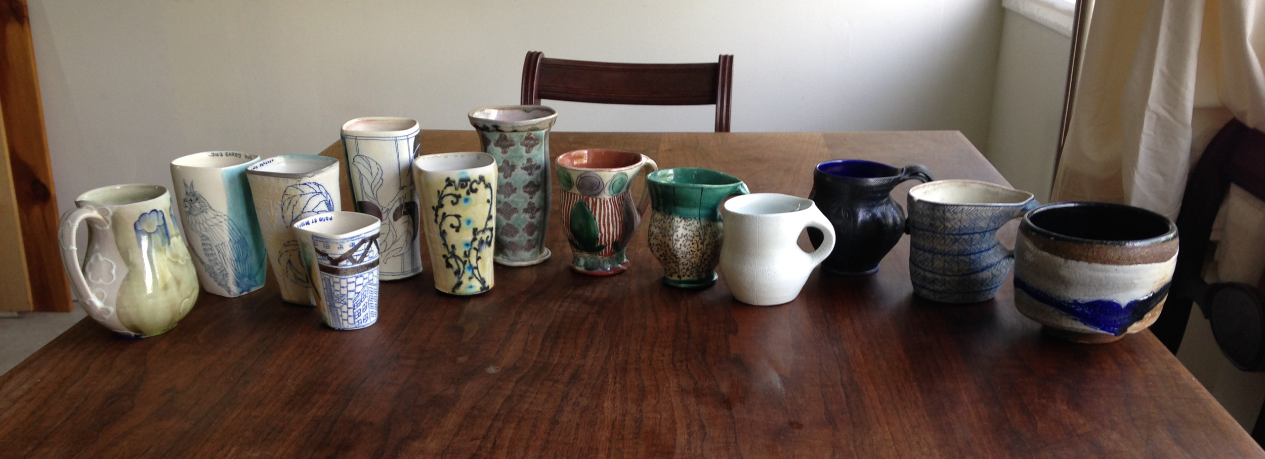 One of the greatest parts of this project was finding these older cups of Julia Galloway's sprinkled among the wall of cup.  She told me that she kept one piece of her own from each year.  A visual record of her life's work, if you may.  I really LOVED this and thought  this should be shown.  So from left to right you see her most recent work trailing over to some of her first pieces.  It's quite a journey!