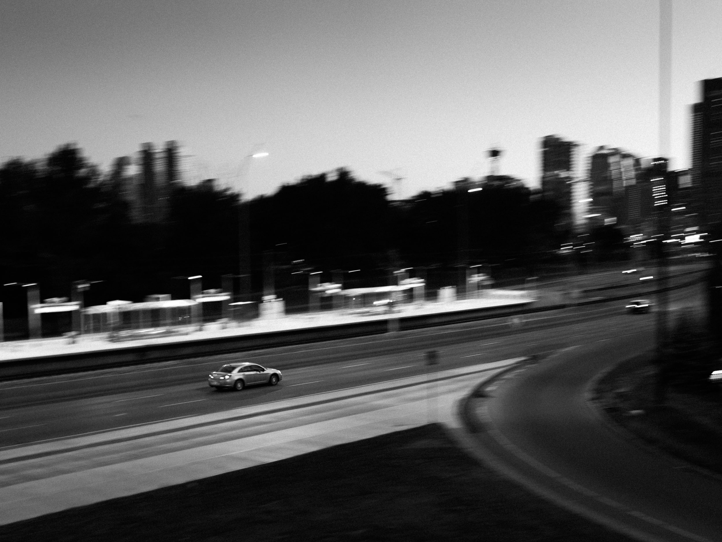 Part of the goal of these blog posts is about finding ways to make photos that look unlike my other photos. Panning, motion blur, and black and white made that happen in this one.