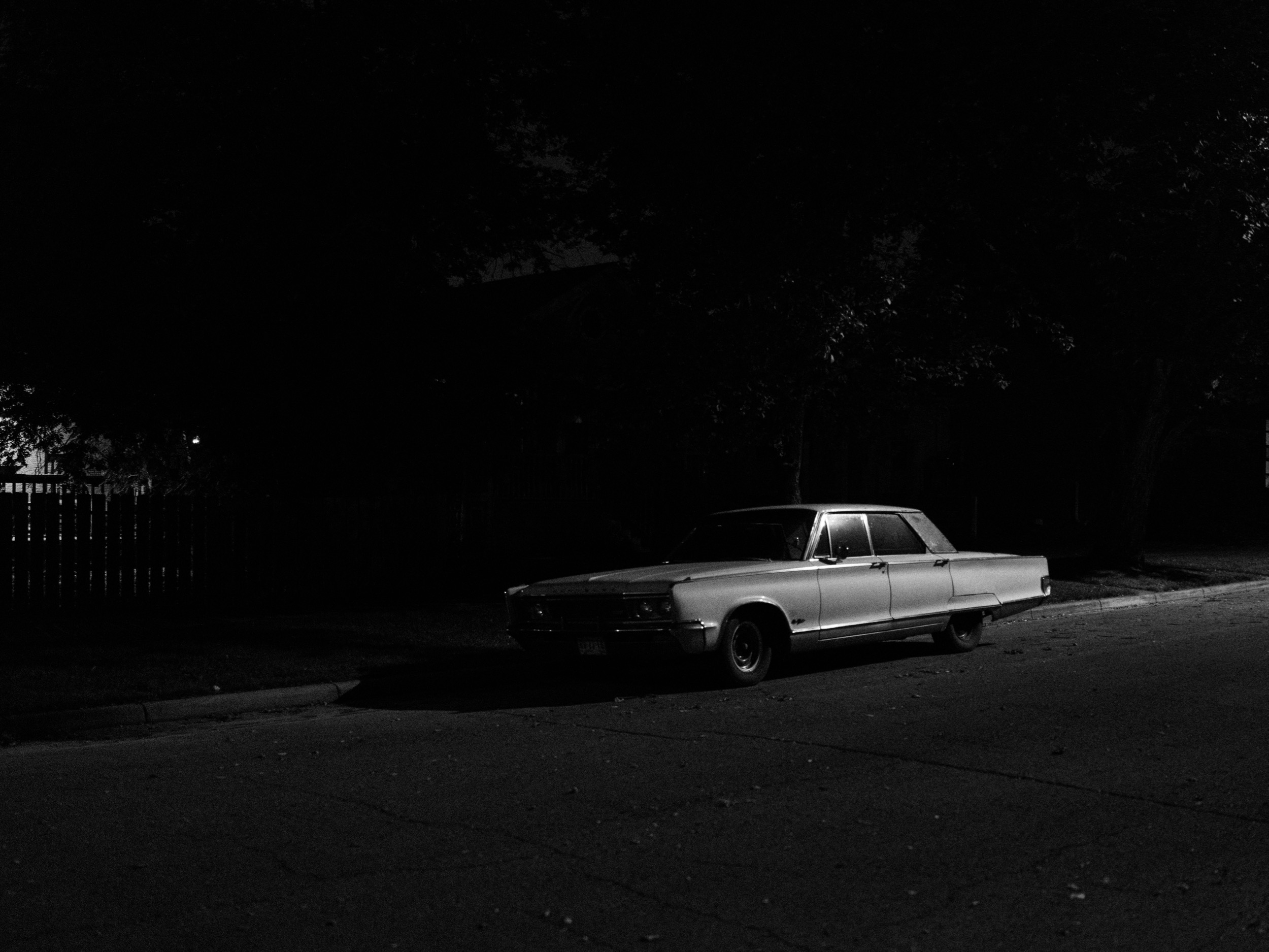 This photo walk happened late at night with strong winds. I could feel the anxiety that Robert Adams described. At any moment, a sound in the distance can conjure a feeling of dread, but it's all part of the excitement. And I found a classic car—it couldn't get better.