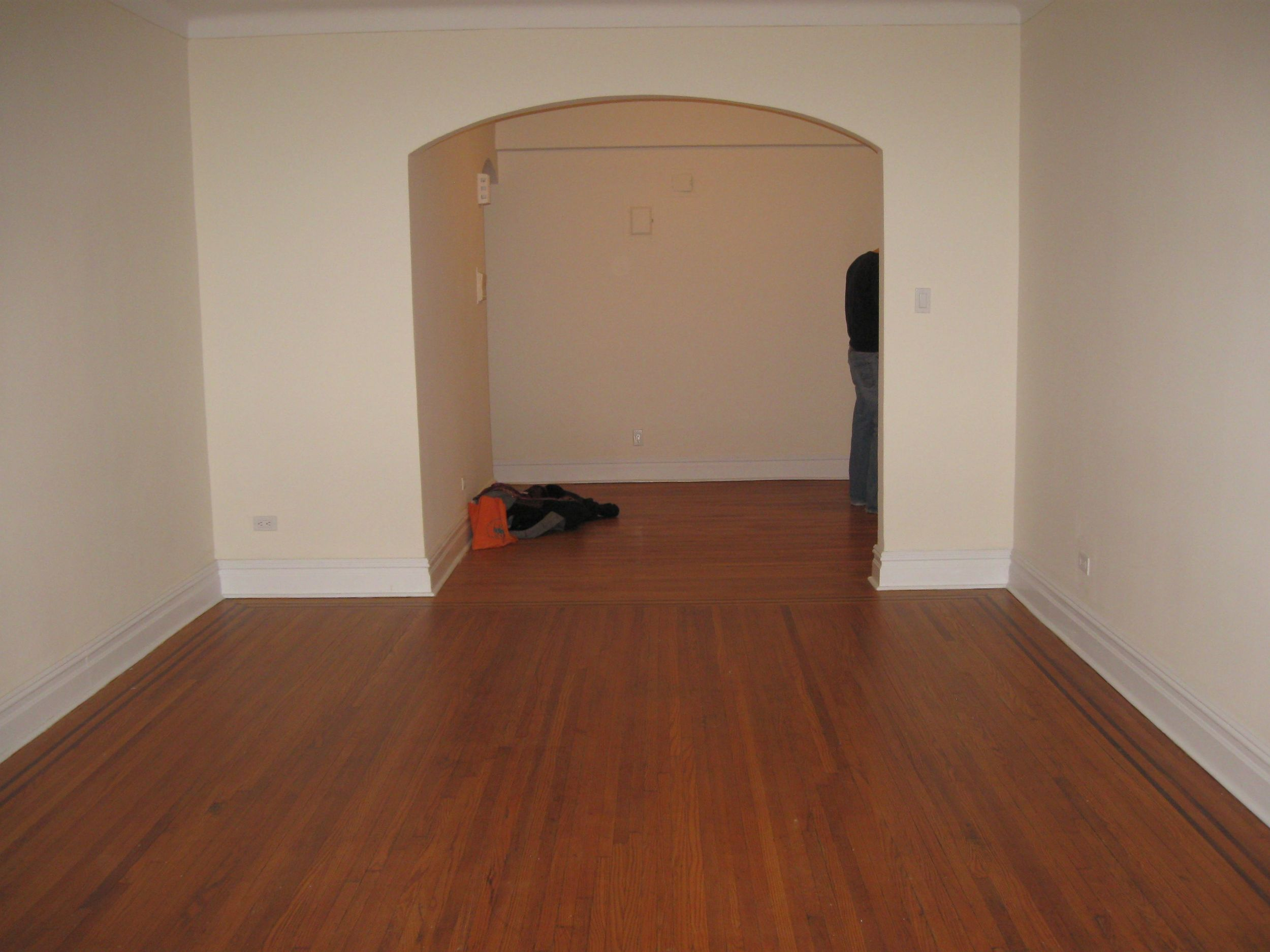 Living room from far wall, looking at foyer.jpg