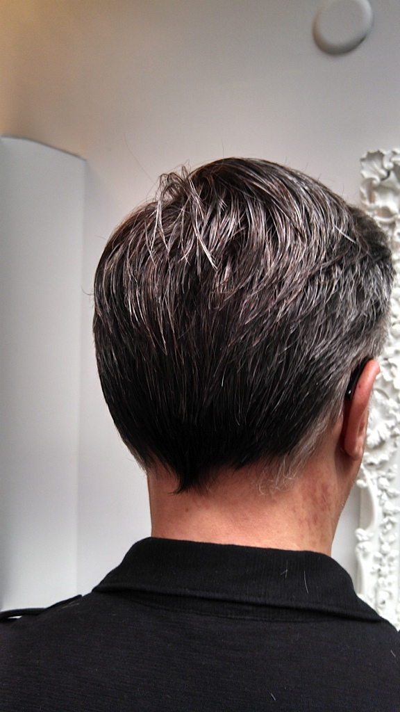 After the hair system is cut into the clients growing hair, it can be styled however they desire. First after pic..jpg